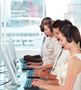 Call center workers with headsets