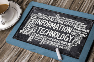 information technology with related word cloud handwritten on bl