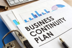 Business continuity plan in a blue folder