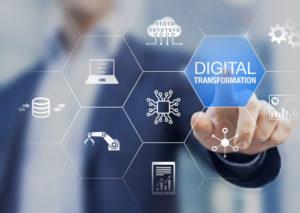 "digital transformation concept with man pointing to text that says ""digital transformation"" next to tech symbols."