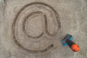 email sign in the sand.