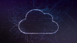 lit up outline of a cloud against a dark background to illustration cloud computing.
