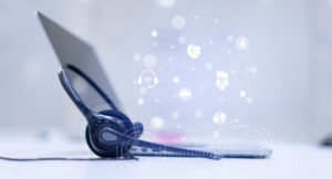 close up of headset and laptop with floating icons for cloud contact center concept