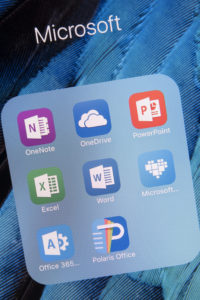 A smartphone screen with Microsoft Office app icons, including OneDrive, OneNote, Excel, Word and more.