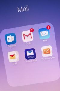 Mail apps, including Microsoft Outlook, on an iPhone screen.