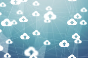 A network of small white cloud icons with arrows in the middle joined by faint lines to symbolize cloud computing.