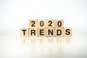 "Wooden blocks on a reflective surface spell out ""2020 TRENDS,"" representing tech trends to watch this year."