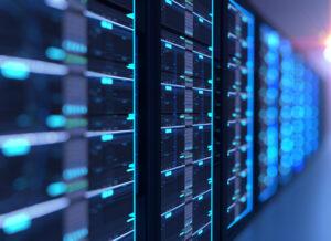 A row of server racks in a data center illustrate data center infrastructure.
