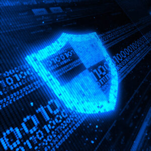 A glowing blue shield superimposed over blue binary on a black background, symbolizing cybersecurity defense in depth.