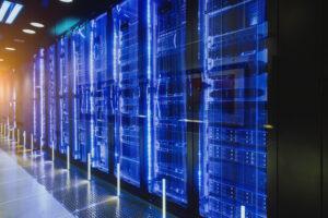 Server racks in a server room illustrating data center services.