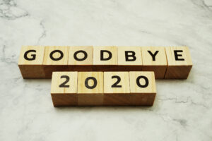 Wooden blocks against a white marble surface that spell out GOODBYE 2020.