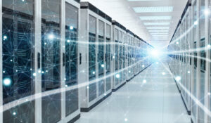 Rows of servers in a data center with glowing dots along the corridor.