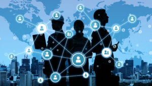 Unified communications and networking concept illustration showing silhouettes of people against a blue background with circles connected with lines over them.