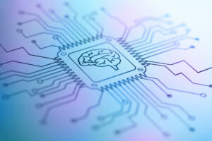 A light blue and pink circuit board diagram with a drawing of a brain at the center, symbolizing artificial intelligence.