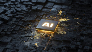 A grey and gold circuit board with glowing gold letters that say AI in the middle, standing for artificial intelligence.