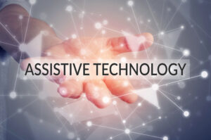 """A close up of an extended hand with the words """"Assistive technology"""" floating over the palm."""