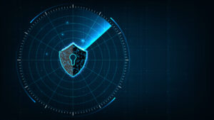 An image of a shield with a keyhole in it in the center of a radar display, representing cybersecurity threat scanning.