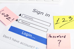 A sign in screen surrounded by post-it notes with passwords such as 1 2 5 written on them.